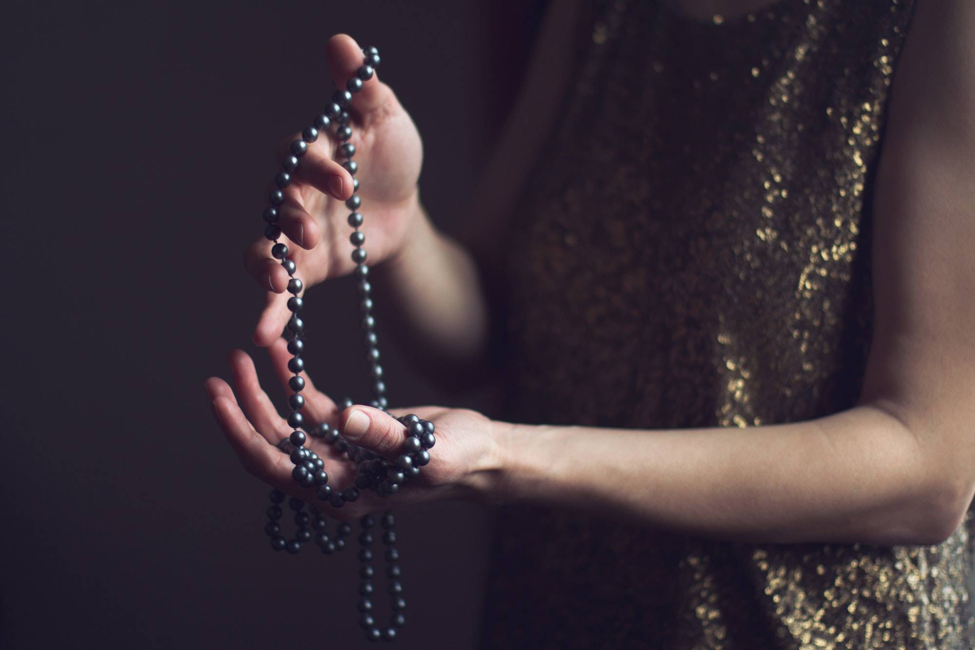 woman with pearls in her hands